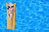 picture of mattress  - Sexy girl floating on a mattress in the sea or swimming pool - JPG