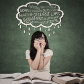 picture of peer-pressure  - Worried student with cloud of her problems in the class - JPG