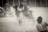 stock photo of charioteer  - Roman chariot in a fight of gladiators - JPG