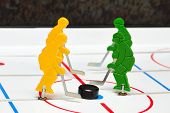 pic of bandy stick  - Two and two hockey players attack each other - JPG