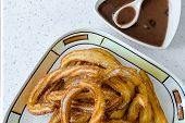 stock photo of churros  - Typical Spanish fried pastry for dessert  - JPG