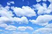 stock photo of puffy  - Clouds background - JPG