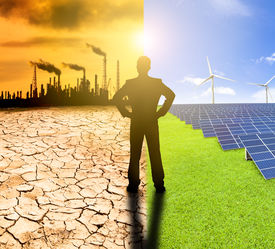 stock photo of windmills  - pollution and clean energy concept - JPG