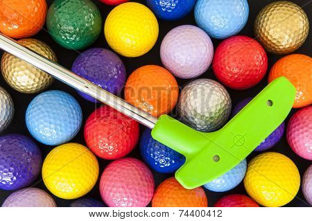 Green Golf Putter With Colorful Balls