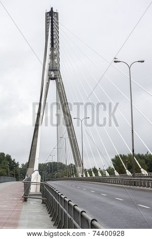 The Holy Cross or Swietokrzyski bridge over the Vistula river in Warsaw, Poland