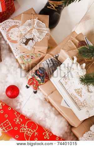 Boxes with gifts under a christmas fur-tree