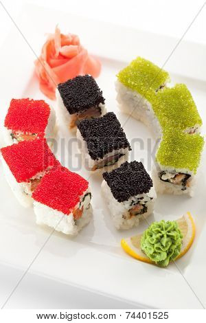 Maki Sushi with Fresh Salmon, Eel and Tuna inside. Topped with Tobiko
