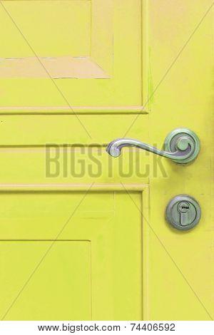 Classic Door Handle On Yellow Door