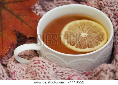 Cup Of Hot Tea With Lemon And Scarf