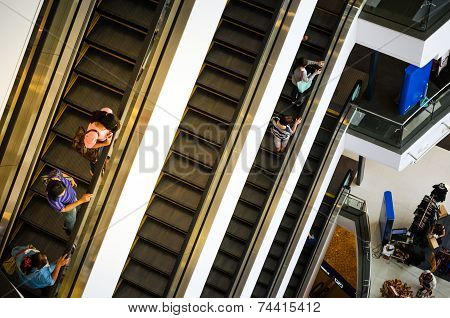 Bangkok, Thailand - September 12, 2013: Shoppers On Escalator At Terminal21 Shopping Mall
