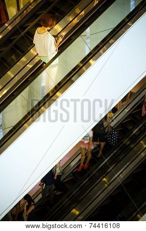 Bangkok, Thailand - September 12, 2013: Shoppers On Escalator At Terminal21