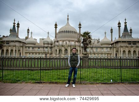 Man standing in front of Royal Pavillion in Brighton, England