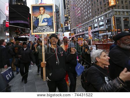 Marcher with sign in Times Square