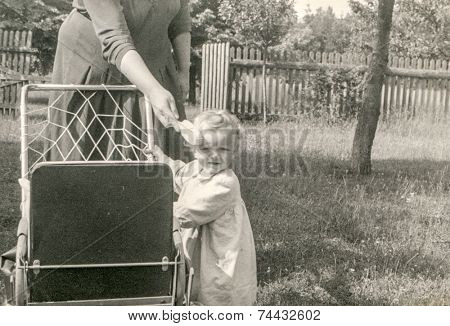 Vintage photo of mother and baby daughter, 1955