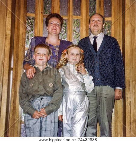 Vintage photo of parents with daughter and son, eighties