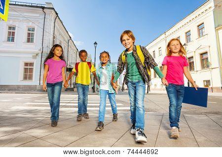 Kids diversity walking together holding hands