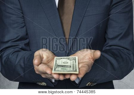 Businessman With Money On Hand