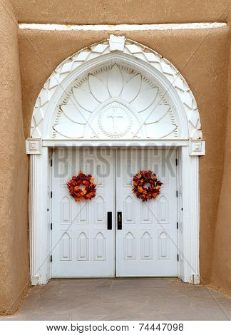 The white door to the San Francisco de Asis Church in Taos, New Mexico