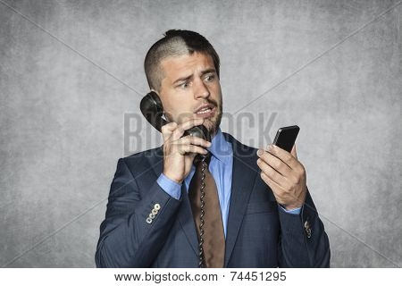 Businessman Talking On The Phone And Reading Email