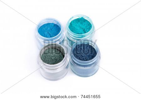 Set of mineral eye shadows in blue color, isolated on white background