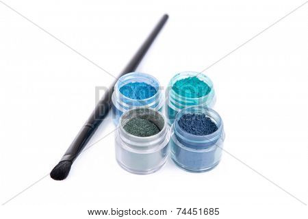Set of mineral eye shadows with make-up brush, isolated on white background