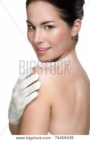 Beautiful Young Woman Applying Scrub Treatment On The Skin
