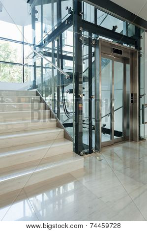 Elevator Next To Staircase