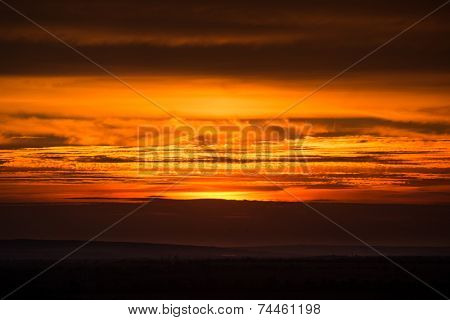 dramatic sunset photo with dark clouds