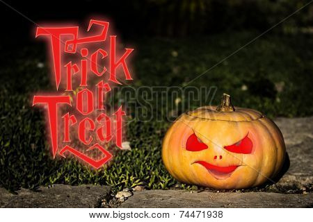 Trick Or Treat Scary Pumpkin on The Grass