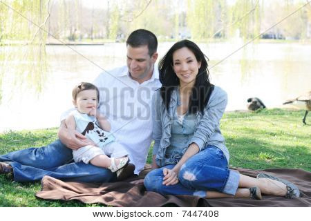 Beautiful Family Enjoying The Park
