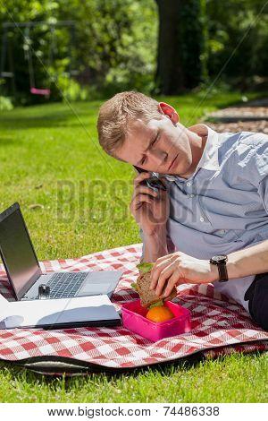 Man Eating Lunch In Garden