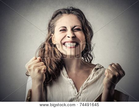 Young woman jubilating