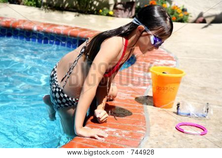 Girl exiting pool
