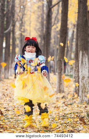 little asian girl dress in snow white costume in forest during halloween
