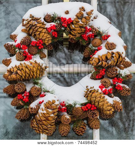 Christmas cone wreath covered in snow