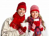 foto of hot couple  - Christmas couple drinking hot tea isolated over white background - JPG