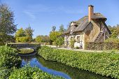 stock photo of versaille  - House with thatched roof in Queen - JPG