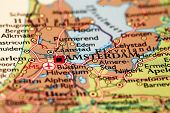 stock photo of atlas  - Amsterdam Netherlands on a printed   atlas world map - JPG