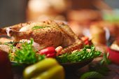 Roasted turkey with vegs and greenery poster