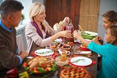 picture of happy thanksgiving  - Portrait of modern family of four having festive dinner on Thanksgiving day - JPG
