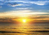 stock photo of beach sunset  - Amazing sunset over the ocean beach - JPG
