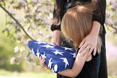 image of funeral  - Daughter holding a parent - JPG