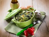 stock photo of turnips  - vegetarian pie with spinach and turnip top - JPG