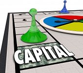 pic of accumulative  - Capital word on a board game with piece moving forward to win financing and funding for a new startup business or company venture - JPG