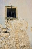 pic of uglich  - Old destroyed window in old cracked wall - JPG