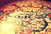 pic of longitude  - China on a printed   atlas world map - JPG
