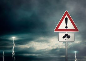 stock photo of lightning-rod  - A dark cloudy sky with lightning bolts and a warning sign in the foreground  - JPG