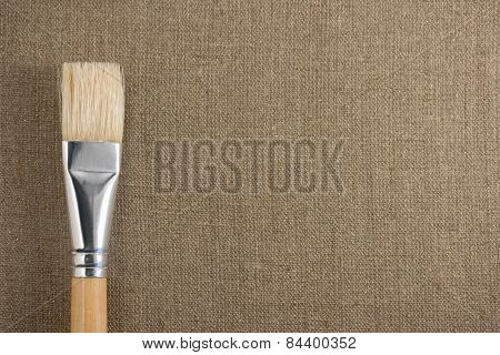 Brush And Canvas On Background