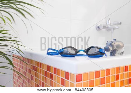 Swimming Goggles On The Bathtub