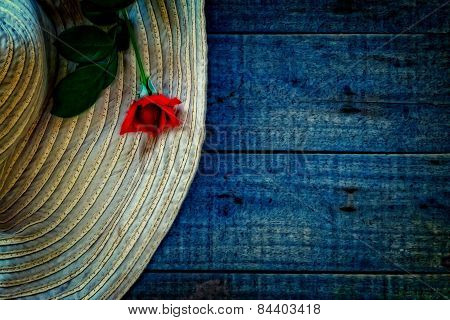 A Digitally Constructed Painting Of  Ladies Sunhat With A Red Rose